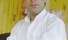 Muzaffar Parray greets people on Eid ul Fitr