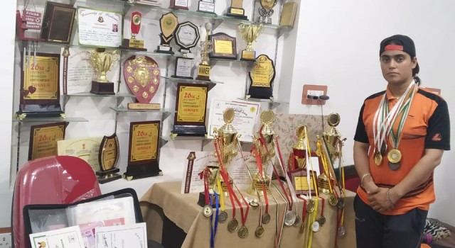 "Azra loves to flaunt in ""SPORTS; a room full of medals and certificates in her house."