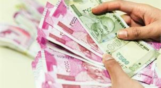 Rupee rises 11 paise to 71.74 against US dollar in early trade